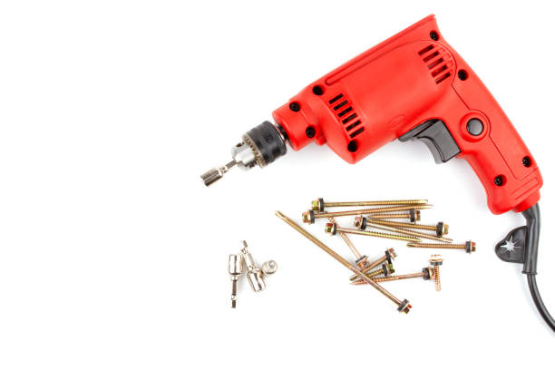 Red electric drill with HEX Drive magnetic drill bit socket driver. Set HEX Drive magnetic drill bit socket driver (8mm) and roof screw install with red electric drill isolated on white background and have copy space. washer fastener stock pictures, royalty-free photos & images