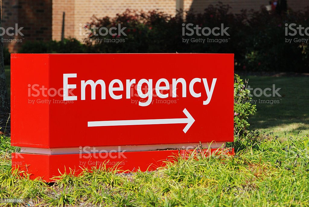 Red emergency room sign with directional arrow stock photo