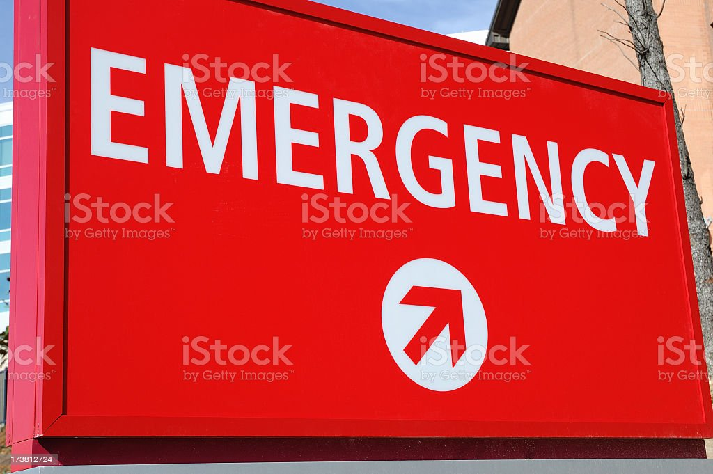 Red emergency sign lightly angled point towards the entrance royalty-free stock photo