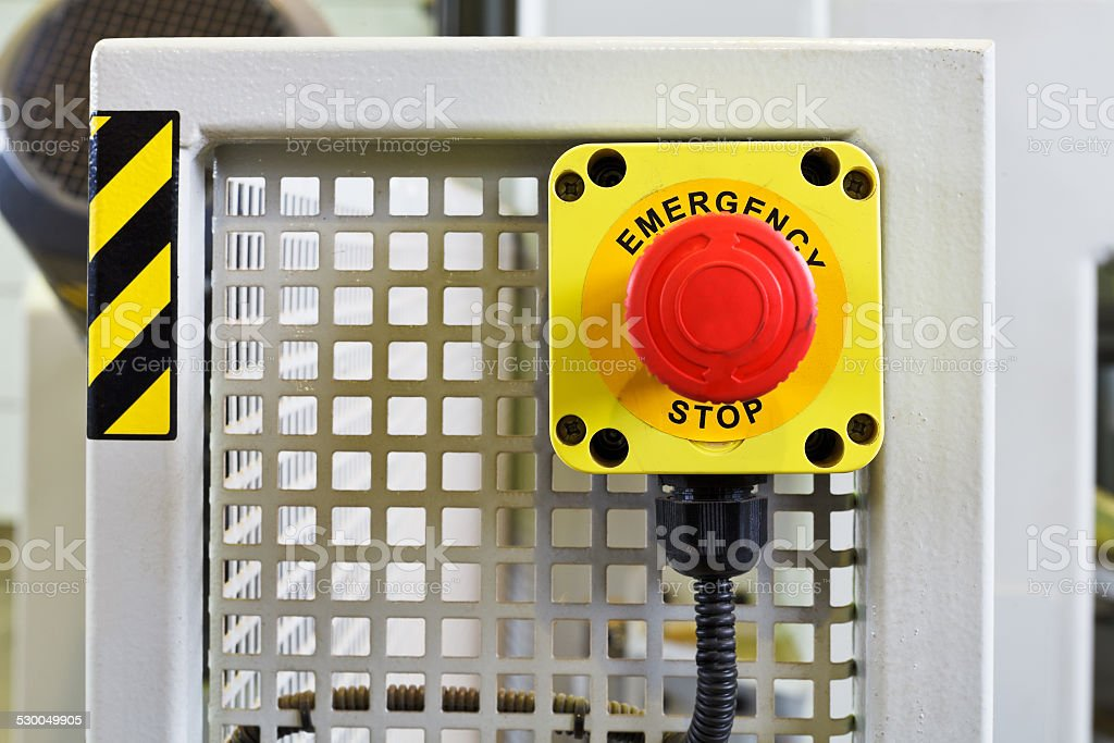 red emergency stop push button on engine stock photo