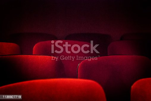 Red old empty theater seats. Shallow DOF.