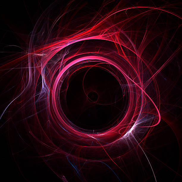 A red energy vortex circle on a black background stock photo