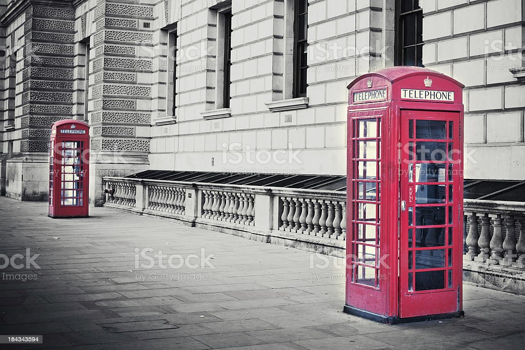 Red English phone booths in black and white photo stock photo