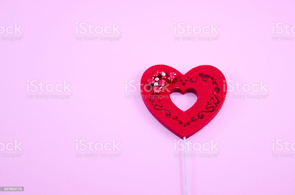 Red engraved heart on pink paper royalty-free stock photo