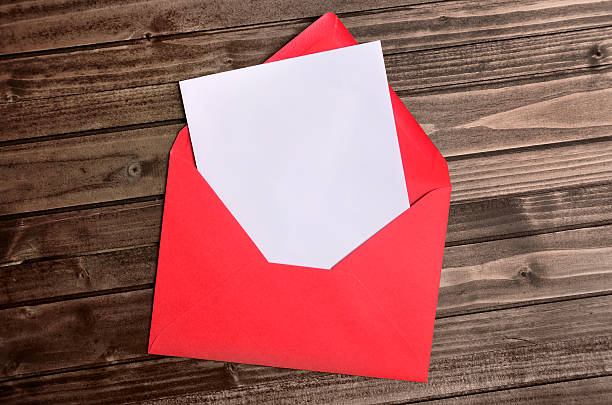 Red envelope with empty paper stock photo
