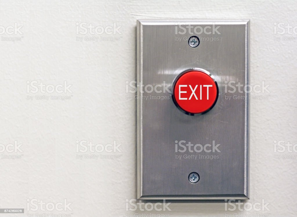 Red exit button on wall stock photo