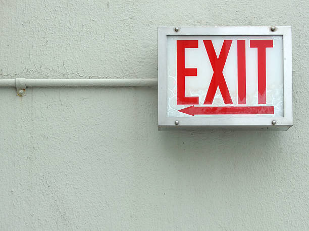 red exit sign - exit sign stock photos and pictures