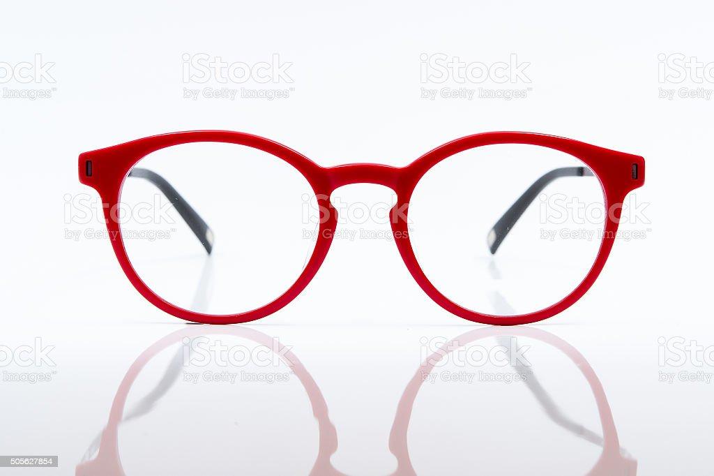 Red eye glasses isolated on white background stock photo