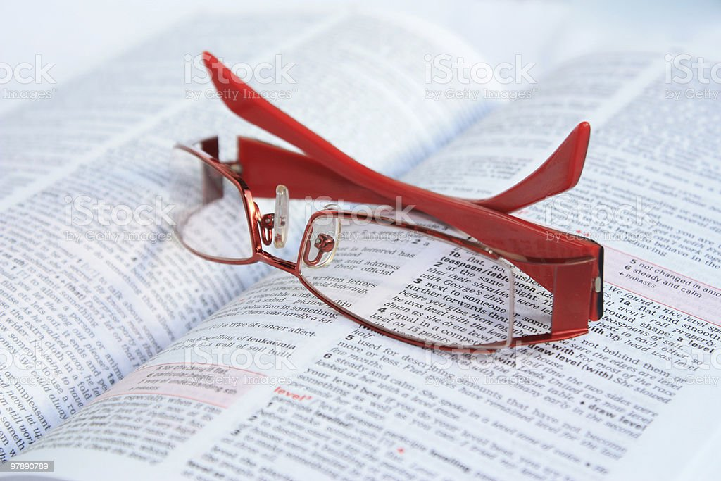 Red eye glasses on dictionary page royalty-free stock photo