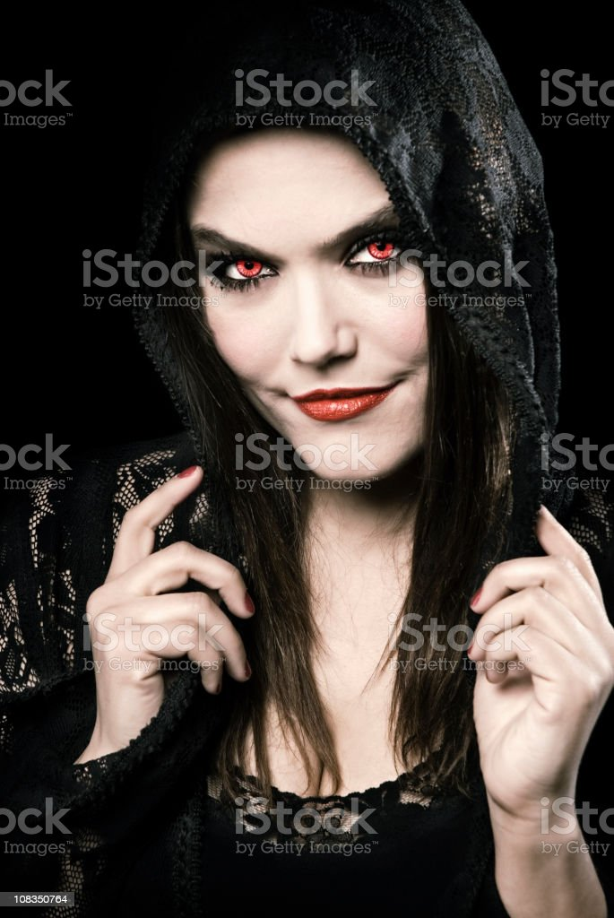 Red eyed beautiful devil stock photo