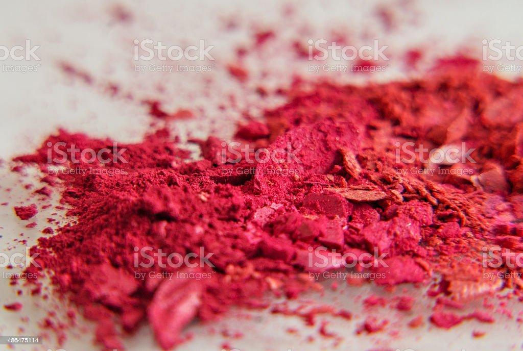 red eyeshadow in loose broken powder stock photo