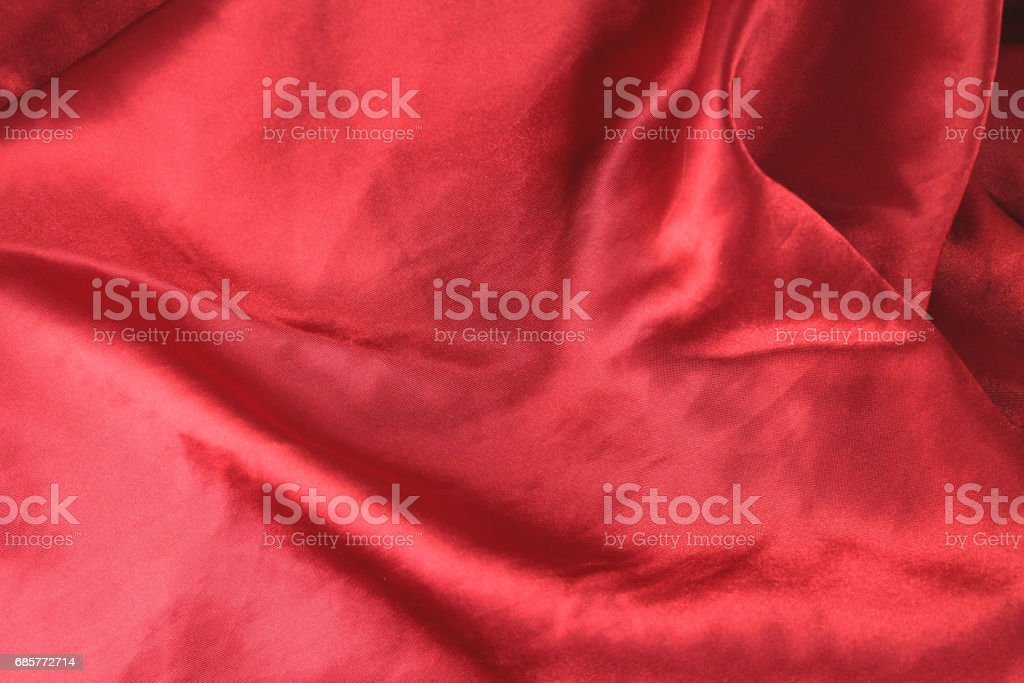 Red fabric background texture wave. Pink silk fabric close-up with an overflow of light and a delicate contrast. Symbol of love, sex, passion, tenderness royalty-free stock photo
