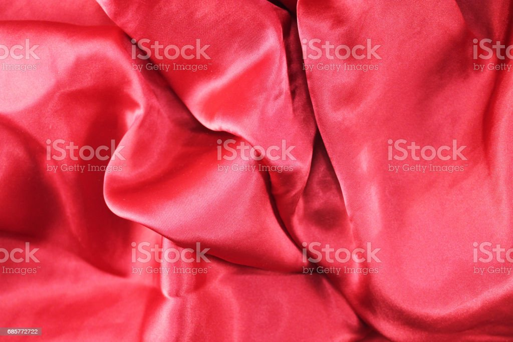 Red fabric background texture wave. Pink silk fabric close-up with an overflow of light and a delicate contrast. Symbol of love, sex, passion, tenderness photo libre de droits
