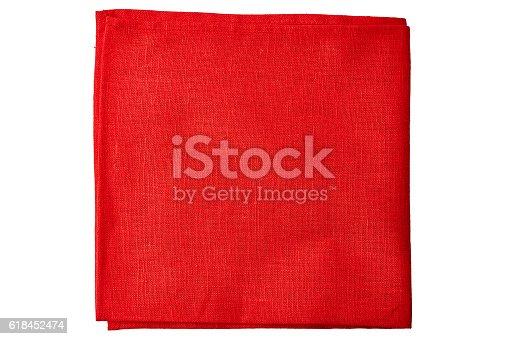 Red fabric napkin isolated on white background