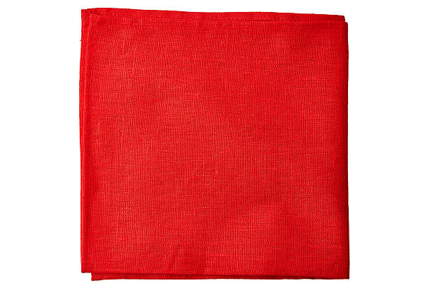 Red fabric napkin on white Red fabric napkin isolated on white background red cloth stock pictures, royalty-free photos & images