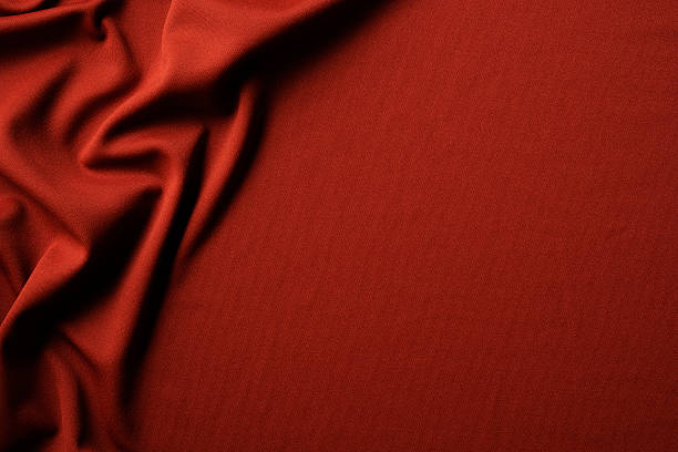 Red fabric texture of wave pattern with copy space stock photo