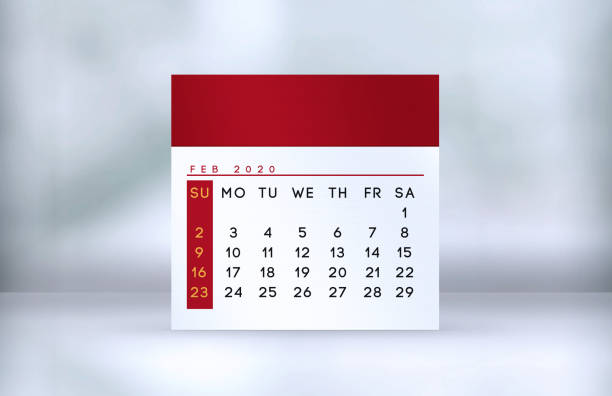 Red February desk calendar stands on the table stock photo