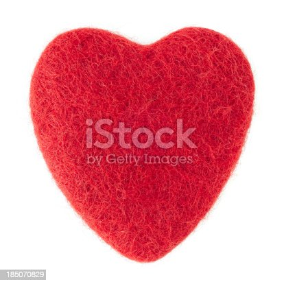 Close up of a red felt heart shape on a white background