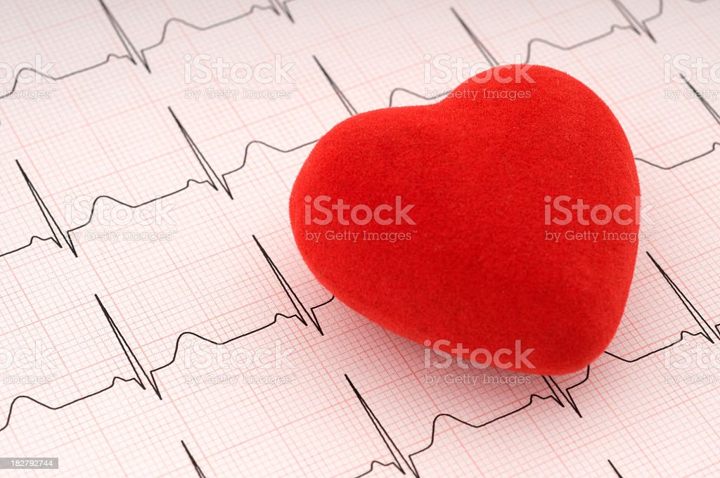 Red felt heart on ECG printout stock photo