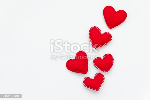 Red felt hearts on white background. Valentines day or Woman's day holidays concept. Top view.