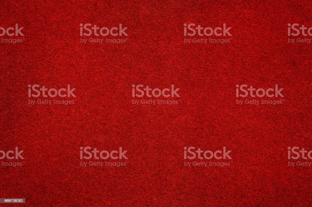 Red felt surface close up. Texture and background stock photo