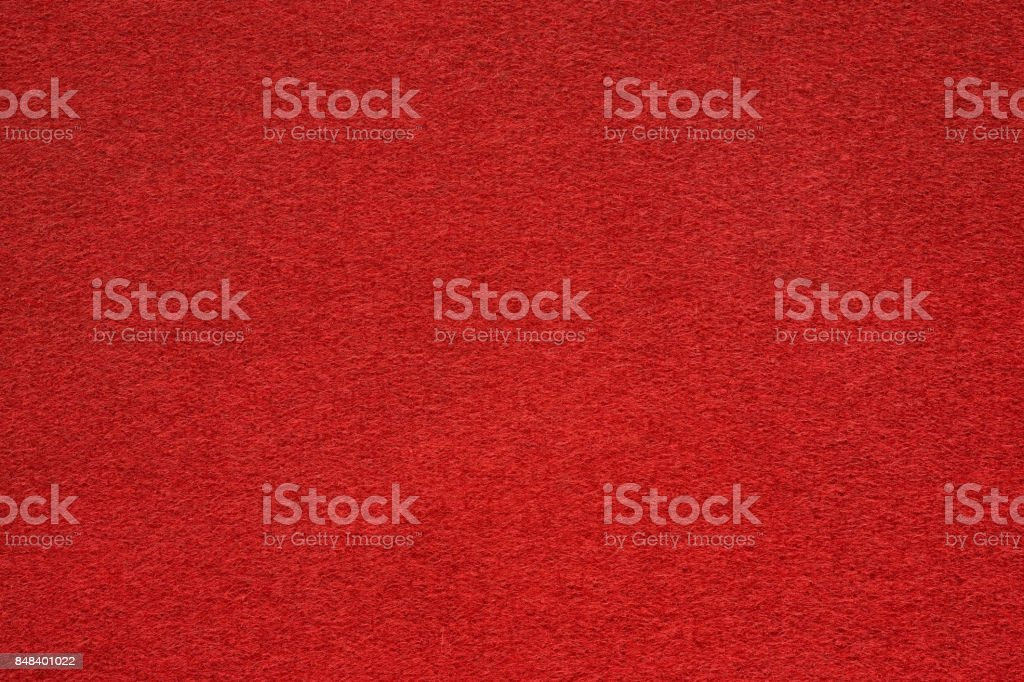 Red felt table surface extremal close up stock photo