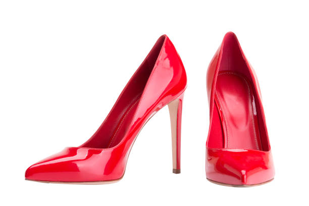 Red female shoes on a white background Red women's high-heeled shoes human foot stock pictures, royalty-free photos & images