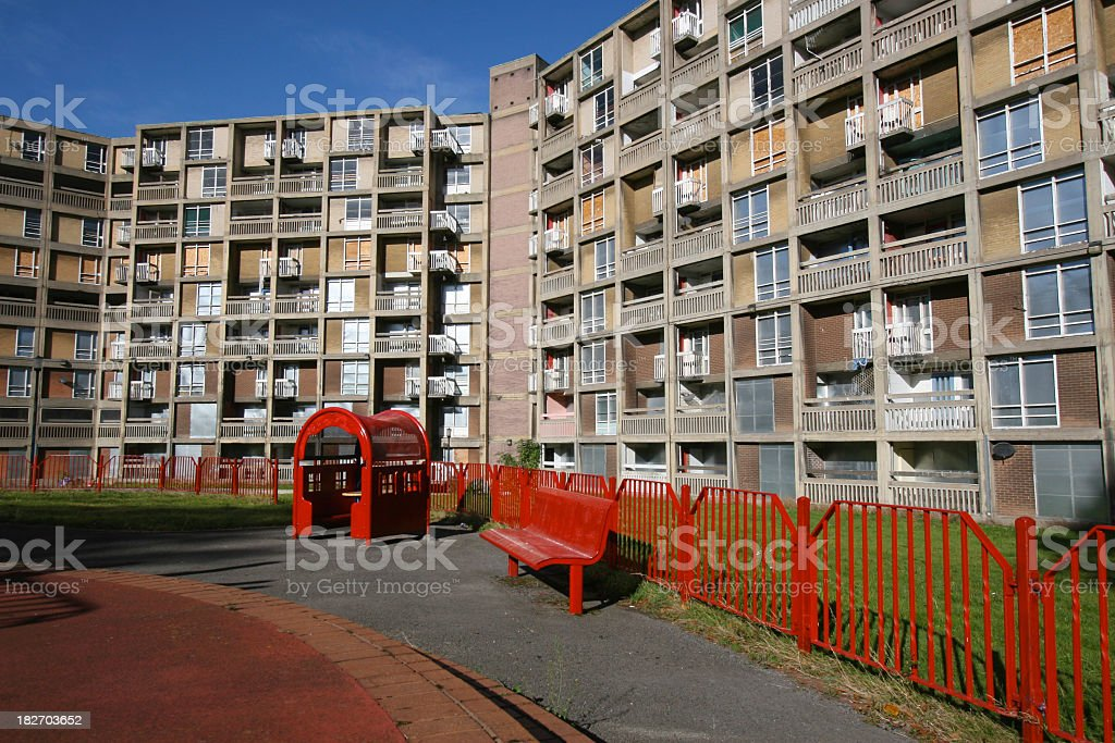 Red fence in front of Park Hill Flats, Sheffield England  stock photo