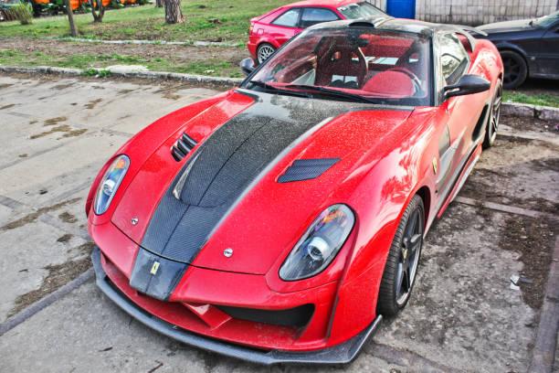 Red Ferrari 599 GTB Fiorano Stallone Mansory in the city stock photo