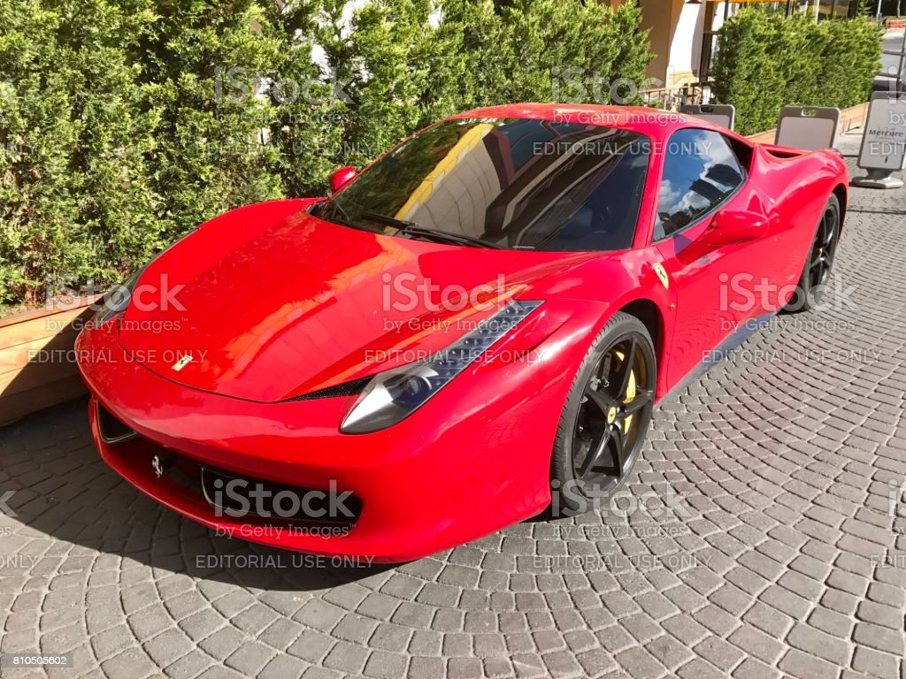 Red Ferrari car parking in the street stock photo