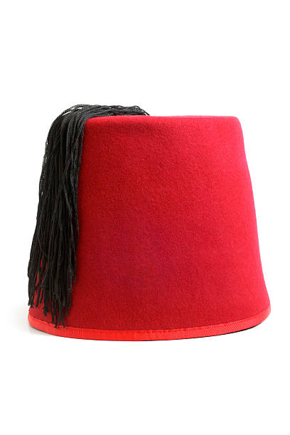 Red fez hat from Turkey isolate on white stock photo
