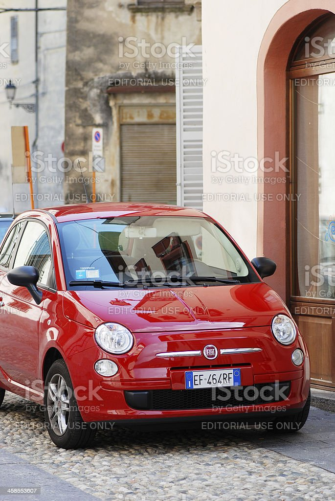 Red Fiat 500 parked in the street royalty-free stock photo