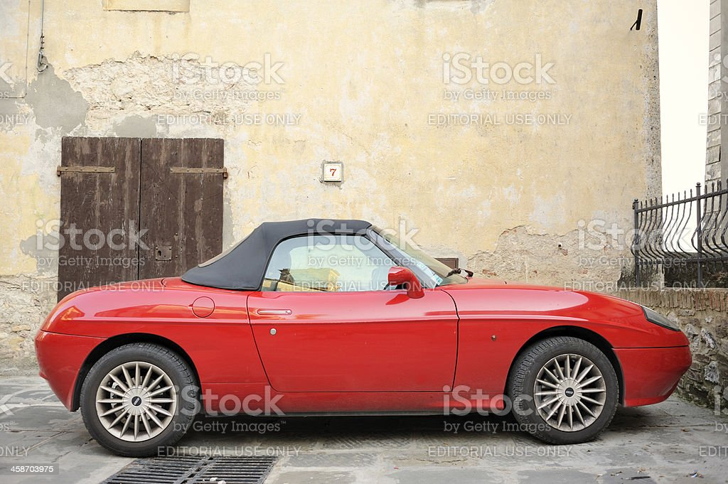 Red Fiat Barchetta in Tuscany royalty-free stock photo