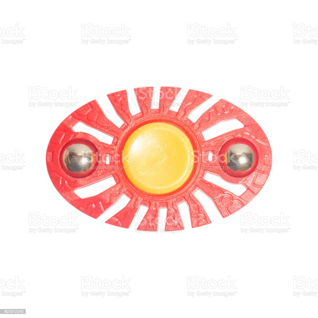 Red fidget finger spinner on white isolated background stock photo