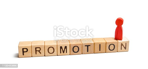 483424715 istock photo A red figure of a man standing on the dice with the words promotion. concept of success and improvement in work, the universal recognition of efficiency and leadership qualities. Talent, leader 1133450880