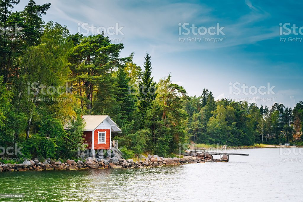 Red Finnish Wooden Bath Sauna Log Cabin In Summer stock photo
