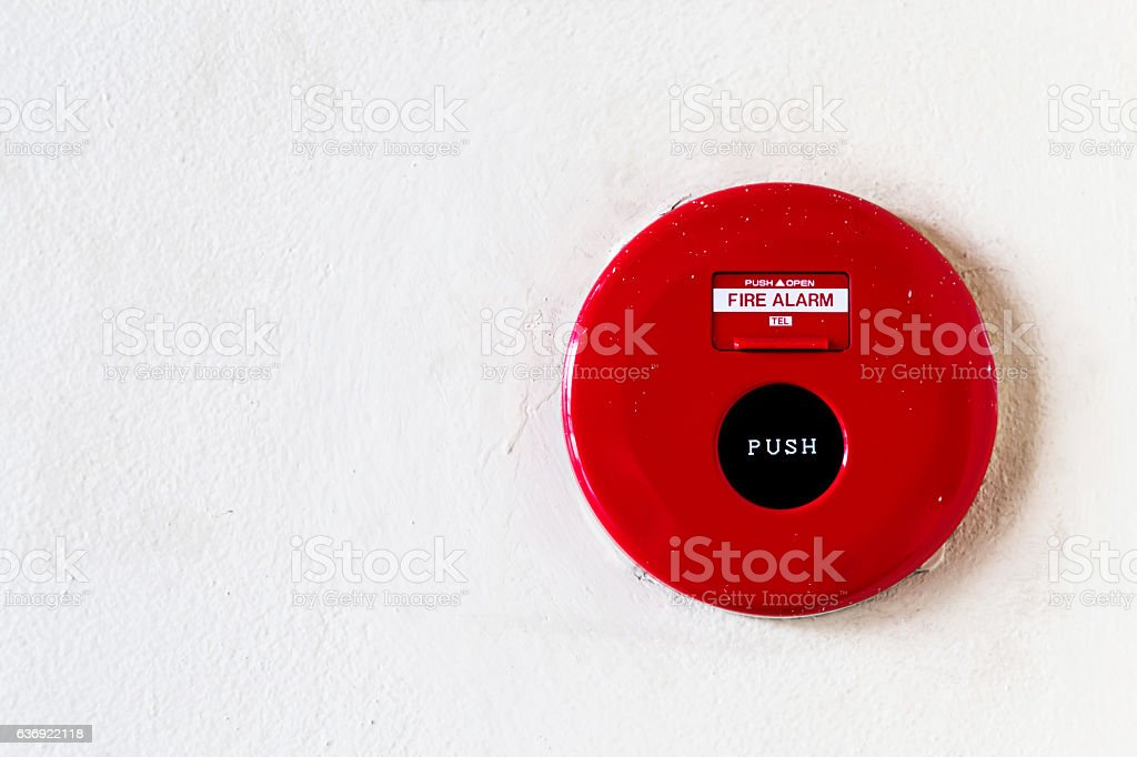 red fire alarm bell on the white wall background. stock photo