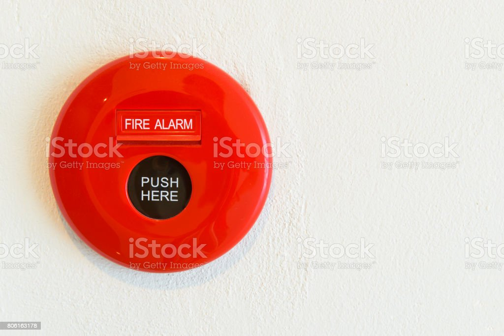 Red fire alarm on a wall stock photo