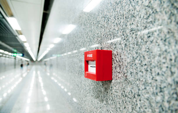 Red fire alarm on the wall of corridor stock photo