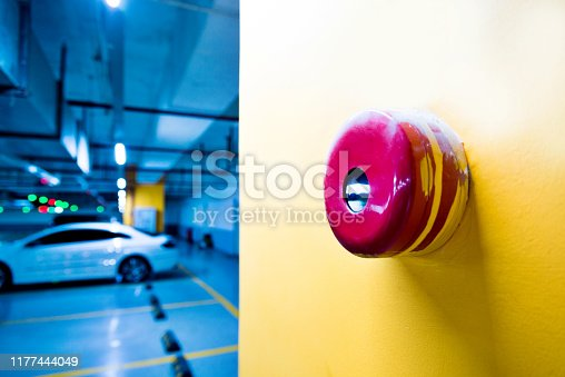 istock Red fire alarm on yellow wall 1177444049
