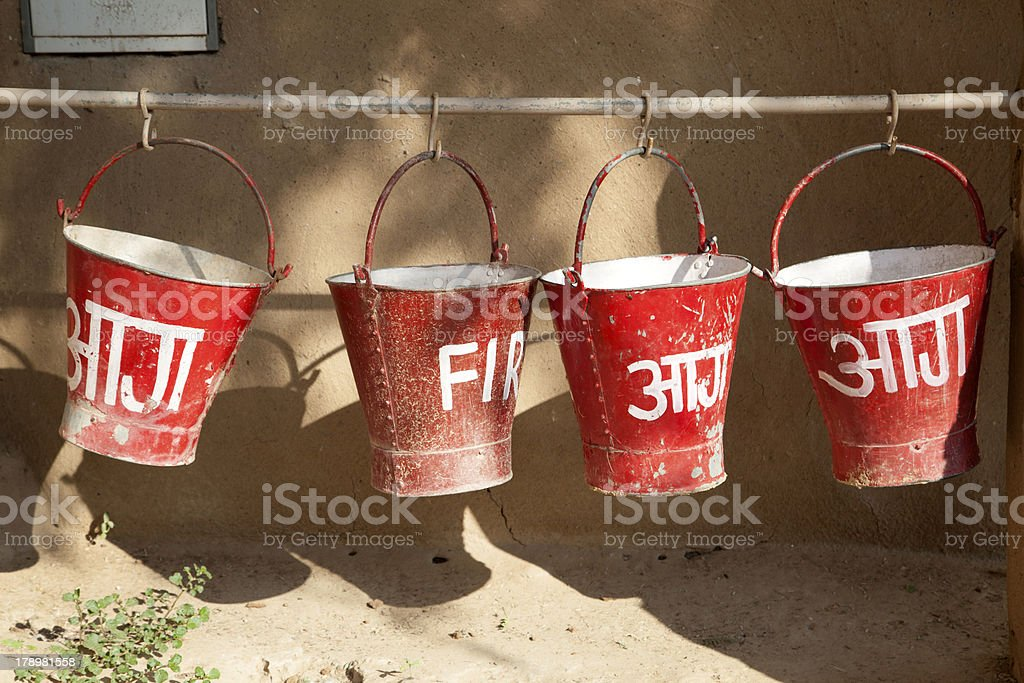 red fire buckets filled with sand royalty-free stock photo