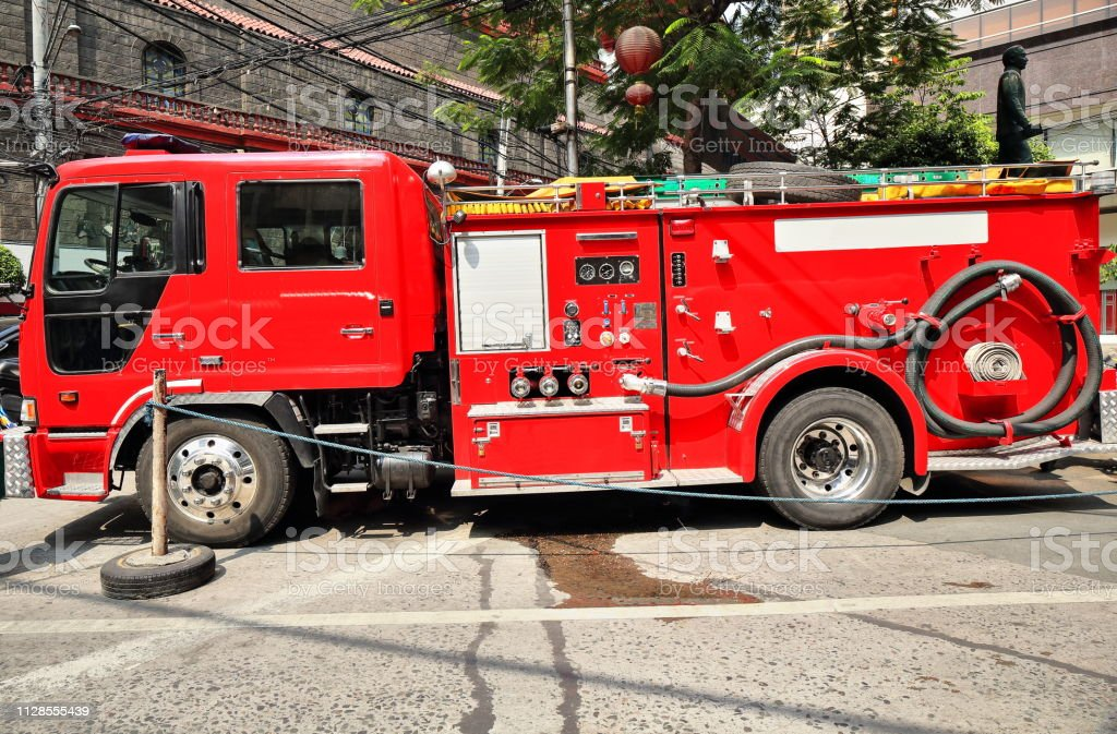 Red fire engine in shift hours parked at Ongpin Street off the Minor...