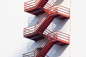 red fire exit stair, outdoor fire escape ladder
