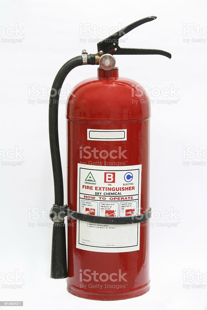 Red fire extinguisher isolated on white back stock photo