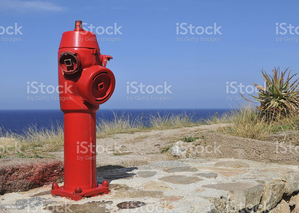 Red fire hydrant, Corsica, France stock photo