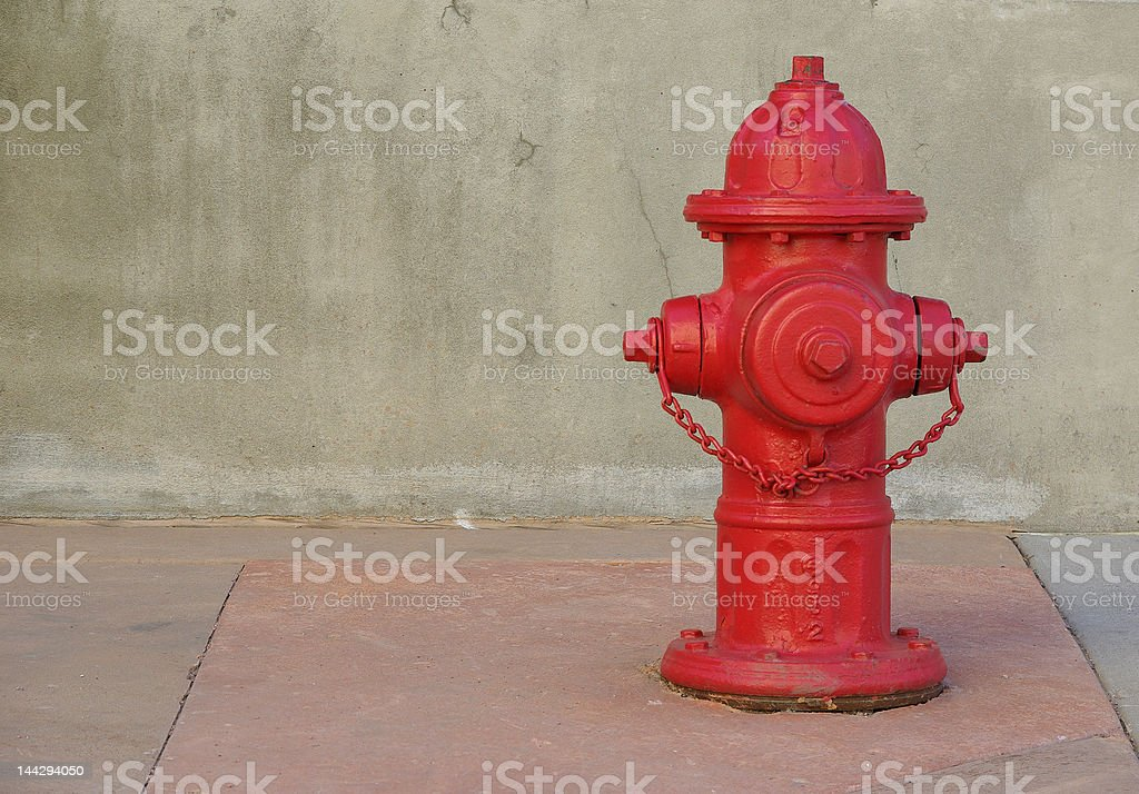 Red fire hydrant on a sidewalk. stock photo