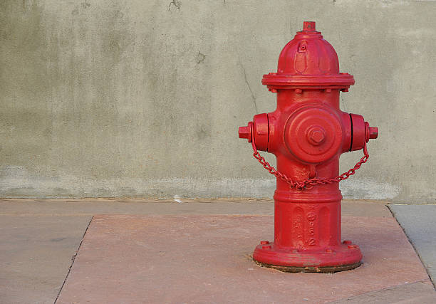 Red fire hydrant on a sidewalk. Fire hydrant on a sidewalk set to the right. fire hydrant stock pictures, royalty-free photos & images