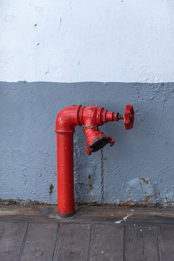Red fire hydrant on the deck of passenger ship
