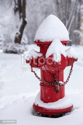 A red fire hydrant in the snow.