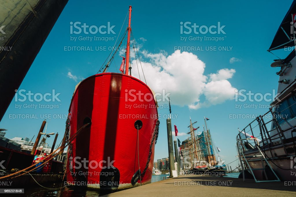 Red fire patrol boat in the port of Hamburg with a restaurant on the board zbiór zdjęć royalty-free